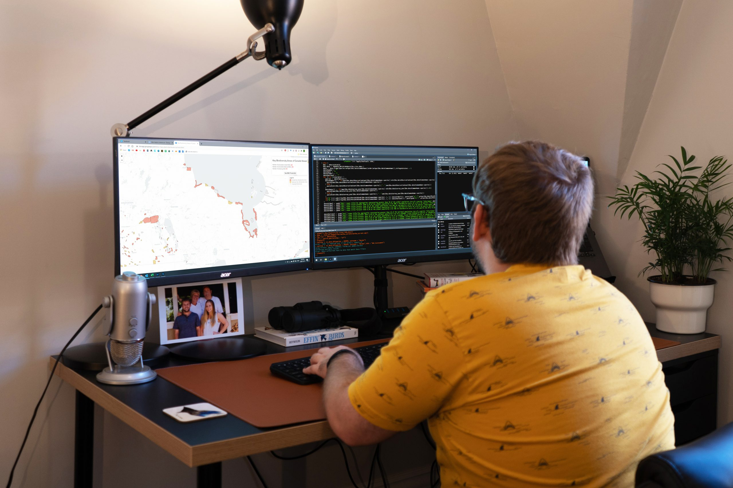 A Birds Canada staff working on his computer at home